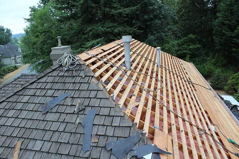Removing old roof shingles and planks