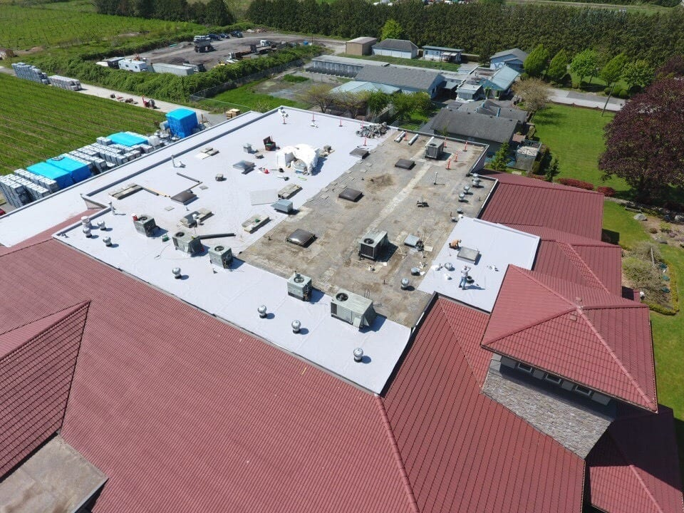 A house roof look covered with full commercial roof