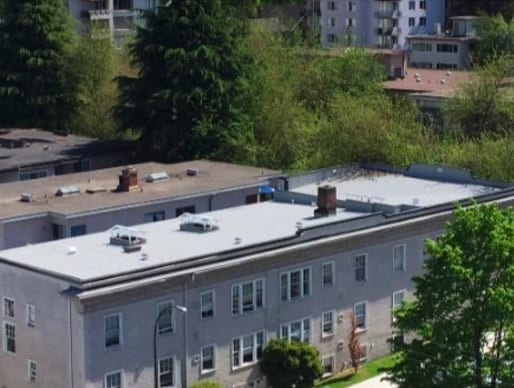 installed plywood roof desk and flat roof system and skylights for commercial property in Vancouver