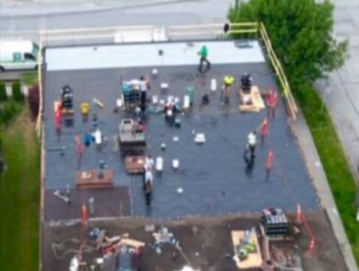 remove over 4000 sqft of old tar and gravel roof and installed 2 ply sbs membrane in new westminster