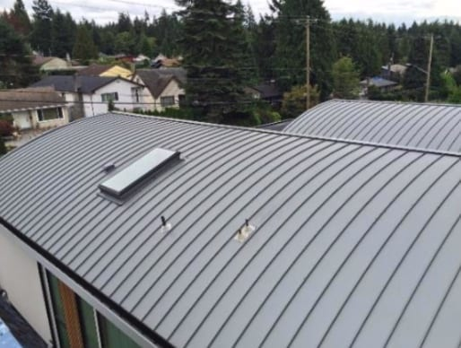 installed torch on roof on Westview Drive in North Vancouver